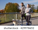 Stock photo fitness sport people and lifestyle concept happy couple with dog running outdoors 429978652