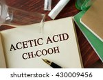 Small photo of Word acetic acid written on a page. Chemistry concept.