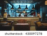Stock photo half lighted hall in a loft style in a mexican restaurant with open kitchen on the background in 430097278