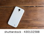 white smartphone lying on a... | Shutterstock . vector #430132588