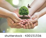 Stock photo parent and children planting together big tree on family hands w butterfly on blur nature greenery 430151536
