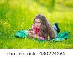 lying woman with phone | Shutterstock . vector #430224265