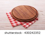 pizza board with a napkin on... | Shutterstock . vector #430242352