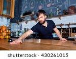 bartender wiping down bar... | Shutterstock . vector #430261015