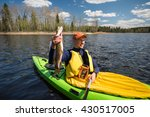 Fisherman In A Kayak Holding A...
