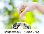 Woman Hand Putting A Coin On...
