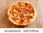 pizza on wooden background | Shutterstock . vector #430725016
