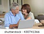senior couple using laptop...   Shutterstock . vector #430741366