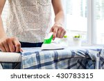 closeup of woman ironing... | Shutterstock . vector #430783315