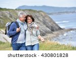 senior couple walking by sea... | Shutterstock . vector #430801828