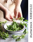 female hands removing spinach... | Shutterstock . vector #430814122
