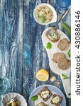 Small photo of Bread with tzatziki on the blue wooden table with accessorize vertical