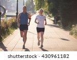 jogging couple warming up and... | Shutterstock . vector #430961182