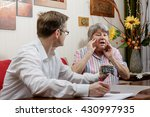 senior is shocked by the amount ... | Shutterstock . vector #430997935