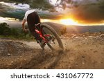 man on mountain bike rides on... | Shutterstock . vector #431067772