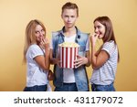 three young people with popcorn | Shutterstock . vector #431179072