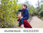 kid boy sitting on mother... | Shutterstock . vector #431212252