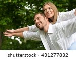 couple  in summer park | Shutterstock . vector #431277832