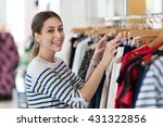 young woman in clothing store  | Shutterstock . vector #431322856