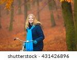 happy active woman riding bike... | Shutterstock . vector #431426896