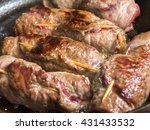 meat rolls cooking on pan | Shutterstock . vector #431433532