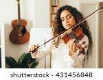 Girl Playing Violin. Young...
