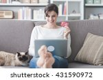 young smiling woman at home ... | Shutterstock . vector #431590972