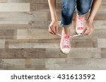woman hands tying sport shoes | Shutterstock . vector #431613592