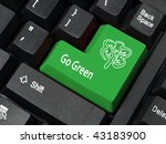 Closeup of computer keyboard key in green color with Go Green phrase and tree symbol - stock photo