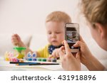 young mother taking photo of... | Shutterstock . vector #431918896