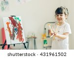 Little Cute Girl Painting  At...