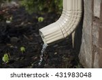A Rain Gutter Downspout With...