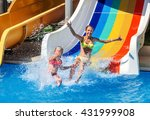 Two Children On Water Slide At...