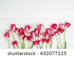 Red Tulips On Wooden Table....