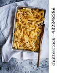 Small photo of Tasty Macaroni or rigatoni and cheese baking cast sheet.