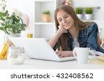 happy girl using laptop | Shutterstock . vector #432408562