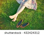 girls legs lying in grass... | Shutterstock . vector #432424312