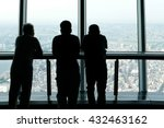 men watch Japan Tokyo city from a tower