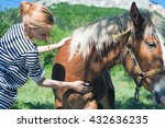 woman petting horse | Shutterstock . vector #432636235