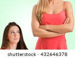 Stock photo height difference between two women in a green background 432646378