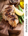 Small photo of Grilled chicken on a cutting board with thyme and green beans