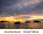 Silhouetted Tourist Sailboat A...