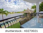Balcony entertainment area of waterfront house - stock photo