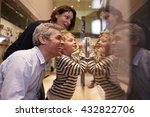 family looking at artifacts in... | Shutterstock . vector #432822706