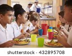 Stock photo primary school kids eat lunch in school cafeteria close up 432895708