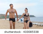 young couple on sand seashore... | Shutterstock . vector #433085338