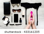 Stock photo top view of female fashion accessories for woman sex toy in the hands sunglasses face powder 433161205