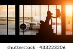 Small photo of Young woman silhouette at Airport with suitcase. Big passengers plane on background. Travel concept of air transportation