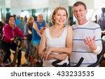 happy elderly couple exercising ... | Shutterstock . vector #433233535