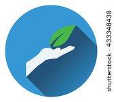 hand holding leaf icon. flat...